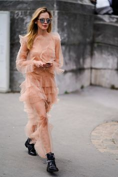 PARIS, FRANCE - SEPTEMBER 30: A guest wears a pink lace dress mesh, outside Elie Saab, during Paris Fashion Week Womenswear Spring/Summer 2018, on September 30, 2017 in Paris, France. (Photo by Edward Berthelot/Getty Images)