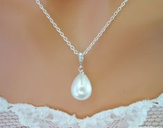 White Ivory Pearl Drop Cubic Zirconia Pendant Sterling Silver Necklace.... super pretty! :)