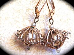 These mid century  gold toned,  caged #vintage pearl, dangle #earrings are converted from vintage screw backs. They are unique and yet very on trend for the current #jewelry s... #christmas #gifts #etsy #handmadejewelry