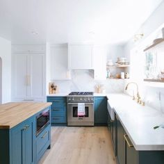 Colored loerrs, white uppers matching wall, butcher block counter