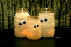 Mason jar, gauze, and googly eyes equals super cute halloween decor. Put a candle inside to glow