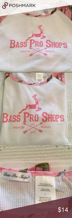 NWOT Cute Bass Pro Shops Top NWOT Bass Pro Shops super cute long sleeve shirt. Never worn, brand new. Size Large. Sleeves are pink camouflage!!  Bass Pro Shops Tops Tees - Long Sleeve