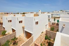 Social housing in Formentera respects tradition and the environment Project Finance, Marine Plants, Low Cost Housing, Wooden Shutters, Site Plans, Ground Floor Plan, Balearic Islands, Building Materials, Conservation