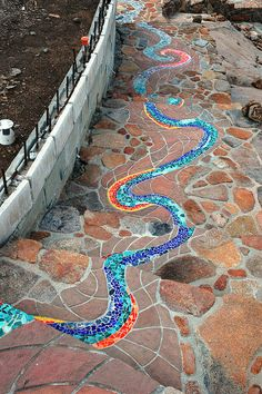 Winding mosaic for stairs and paths leading from residential
