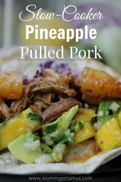 Nothing says summer like Pineapple Pulled Pork! This  easy slow cooker version is making my mouth water.