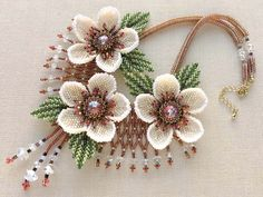 Christmas Rose necklace (found on a Japanese website) The photographer who took the photo shows excellent skill!