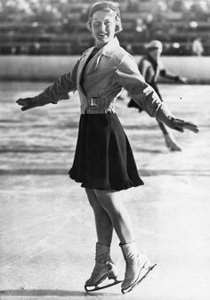 1936 photo of a sharply dressed woman ice skating