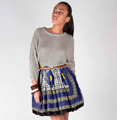 Blue Khanga Print Skirt - Chichia A-line style full skirt with cinched in waist, hip pockets and zip detail. Skirt is designed from khanga print in Blue, White and Yellow material with Tanzanian inscription across centre of skirt. Made in Tanzania.