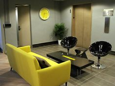 Neon green and black office space design  #officespace #office #lounge