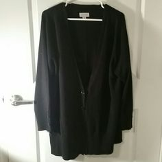Black Sweater Cardigan Black sweater cardigan with black buttons down the front and also on the sleeve. Great condition. Soft, lightweight sweater material, but still warm. Avenue Sweaters Cardigans