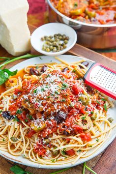 Chicken Puttanesca--Spaghetti alla puttanesca is a classic Italian pasta dish with a sauce consisting of tomatoes, olive oil, anchovies, olives, capers and garlic.