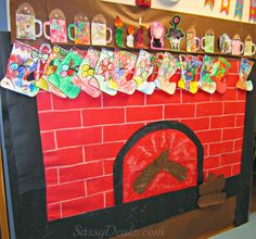 Fireplace Christmas bulletin board.  Students make a stocking and mug. This could be a family homework assignment.