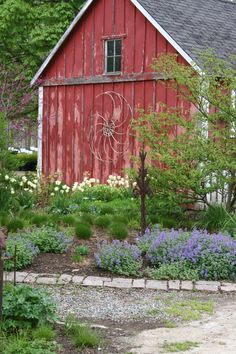 Great complimentary colors between the red building and blue Nepeta.