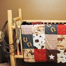 Rustic Homemade Pine Log Baby Crib For A Cabin Or Western Cowboy Nursery With Patchwork Quilt Bedding