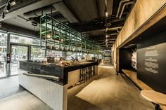 The store design is based on the modern architecture surrounding our store. When you enter there is a free standing bar at which you can sit as well to see what the Barista's are doing.