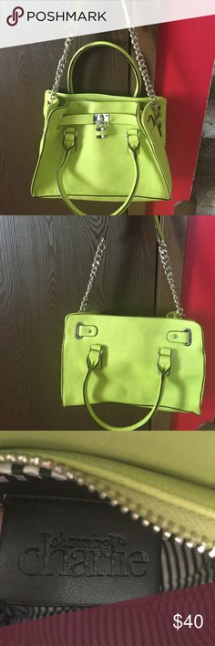 Charming Charlie MK style Hamilton purse Lime This is a very good barely used Michael Kors Hamilton style purse by Charming Charlie.    Color is a bright lime green with a chain silver shoulder strap approximately 12 inches from the top of the bag.   As shown on pics 4 & 5 there are small stains, which are barely noticeable no tears or other stains.   Faux leather material, medium size bag with zebra lining inside and zippered pocket as well.   Please this is a trade free zone but I do…