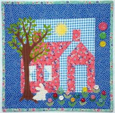 Spring!  This quilt was a giveaway on my blog.  It is made mostly with feedsacks with a few newer fabrics thrown in.