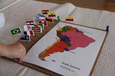 Flagging different countries on a continent with corkboard, toothpicks and mini-maps