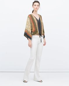 Image 1 of PRINTED KIMONO WITH FRINGING AND ZIP from Zara