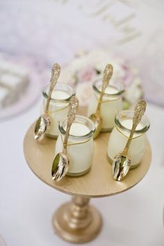 Single serve pudding with gold spoons. Pretty gold dessert stand.