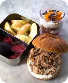 Easy lunch box ideas: barbecue pulled pork with sour cream on an onion roll; lightly salted apples; plum slices; and a parfait made with Greek yogurt, clementines, granola, chocolate chips and honey. http://www.LunchBoxBlues.com
