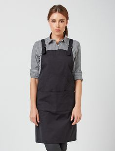 The Tokyo Bib Apron in Black is understated style at its best. It's a fashion forward look that can be styled to a variety of retail and hospitality industry needs, whilst the black canvas suits any colour combination to match your uniform look to your brand. Inspired by the clean lines and premium fabrics of Japanese street-wear, this exclusive design is made from 100% cotton canvas that embraces a relaxed crease. Also available in Khaki and Marine, and as a waist apron. Please refer to…