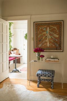 Entry hall styled by Stacie Flinner  // featuring a framed Hermes Scarf  and CB2 lucite console table