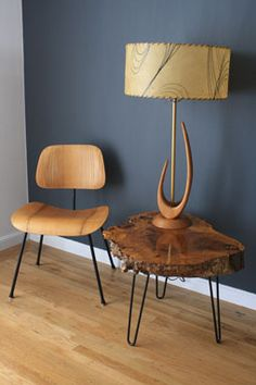 A mid-century corner. I really love that lamp and side table.