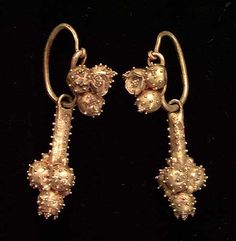 A PAIR OF ROMAN GOLD EARRINGS, ca. With solid gold loops with applied cluster of spheres with small granulations and with pendants also ornamented with spheres with applied granulations. by chrystal Antique Earrings, Gold Earrings, Antique Jewelry, Gold Jewelry, Jewelery, Renaissance Jewelry, Viking Jewelry, Ancient Jewelry, Antic Jewellery