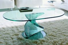 Awesome glass table. In the future, at some point when you and I need furniture, I could model something like this, then commission someone on Etsy to make it. :) Currently, I'm messing with a little room in 3ds Max that I'm thinking about making into a mockup of D. Gallery. If I decide it's worth working on more, I'll post some pictures of it. :) It's not really something I should be working on RIGHT NOW, seeing as we need money ASAP.