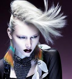 A long blonde straight coloured platinum white quiff flyaway hairstyle by Kevin Kahan