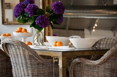 woven Rattan chairs with vintage brass dining table
