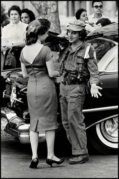 Havana, Cuba, 1959. A young soldier speaking to a woman during the revolution. By Burt Glinn (I LOVE  this picture!  They look so happy.)