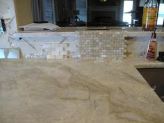 At #QualityStones we provide the best #quality of #stone, Here in this picture, you can see how the colors and stone work together. This #fabricator is using #pearlvenata Quartzite. As you can see this piece of Quartzite accents the kitchen with beautiful light green colors and a splash of white.