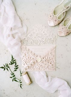 Lace wedding invitation: Photography: Rebecca Yale Photography - rebeccayalephotography.com Read More on SMP: http://www.stylemepretty.com/2017/01/18/if-paris-is-your-dream-wedding-destination-dont-miss-this-one/
