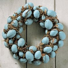 Robin's eggs on a wreath. They are available at most crafts stores. Easy to make with a little hot glue and a wreath form made with either moss or grapevine.... your done. Add a bow if you like, picking up on the beautiful Robin's egg blue.