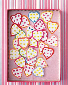 Sweet Spot Hearts  Snip candy hearts for an entire class in a snap. To make, cut a heart from a strip of candy dots, and glue it to a piece of construction paper. With scalloping scissors, cut construction paper to create a border around the heart.