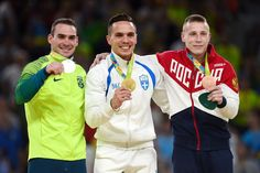 (L to R) Silver medalist Arthur Zanetti of Brazil, gold medalist Eleftherios Petrounias of Greece, bronze medalist Denis Abliazin of Russia pose on the podium at the medal ceremony for Men's Rings on day 10 of the Rio 2016 Olympic Games at Rio Olympic Arena on August 15, 2016 in Rio de Janeiro, Brazil.