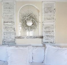 Shabby Chic Mantel Decoration with Old Windows. Use shutters, window with mirror on murphy bed.