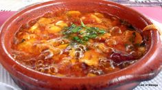 Gambas pil-pil:There is nothing more typical in Andalucían cookery thanspicy prawns served sizzling hotwith crusty bread to mop up the juices – together with a glass of chilled white wine …
