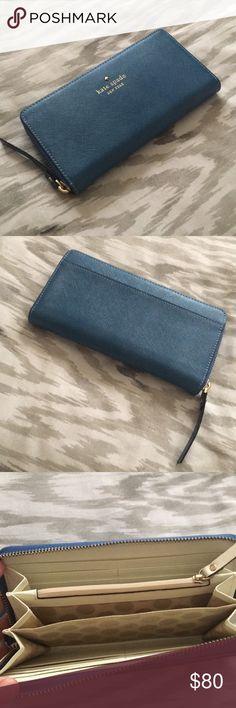 Kate Spade Wallet NWOT Beautiful big blue Kate Spade Wallet. Never used. Super clean and super cute! kate spade Bags Wallets