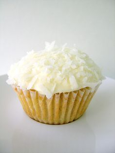 Lemon myrtle cupcakes drizzled with lemon myrtle syrup and topped with coconut frosting.