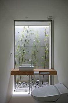 Baños de estilo por 空間建築-傳 一級建築士事務所