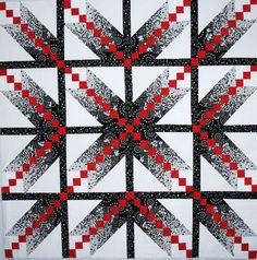 My Debonair pattern minus the borders. The pattern can be purchased at www.mojoquiltdesigns.com