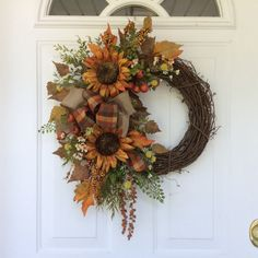 Fall Wreath-Sunflower Wreath-Rustic Wreath-Country Wreath-Cottage Chic-Summer Wreath-Fall Harvest Wreath This welcoming sunflower wreath is perfect for that nook or corner that needs a touch of seasonal flair. The two golden sunflowers have glittered centers and are surrounded by a lovely mix of maple and birch leaves, delicate maidenhair fern and eucalyptus. Rust colored berries, cascading celosia and meadow flowers add a festive touch to this classic autumn design. A pretty double bow of…