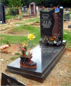 A tombstone that incorporates rustenburg grey granite and african red granite. A beautiful architectural design