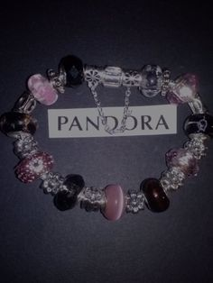 Sterling silver bracelet with pink and black glass murano beads and silver spacers with safety chain.