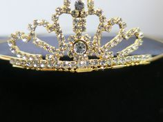 Bridal Rhinestone Crystal Prom Tiara Crown    Gorgeous Classic hair tiara/crown with sparkling rhinestone crystals.  Golden plated metal band.Best for wedding, bridal,prom or for gift.