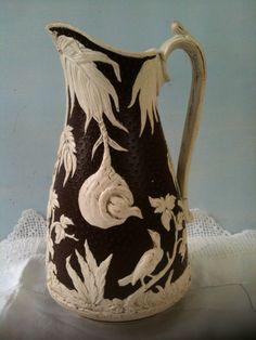 Antique Parian Porcelain Moulded Jug Bird Decoration Brown Leather Effect Finish