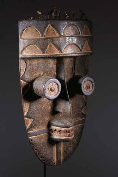 Grebo Mask | Grebo people of the Ivory Coast and Liberia. Grebo war masks are famous for the many cylindrical eyes and long nose, intended to terrify the enemy.